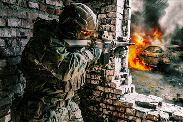 Army soldier in action in ruined building