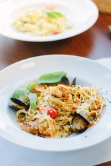 Italian food - spaghetti pasta with seafood - mussels and shrimps.