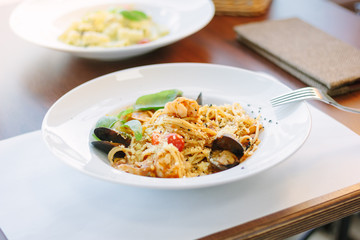 Spaghetti pasta with seafood - mussels and shrimps at italian food restaurant.
