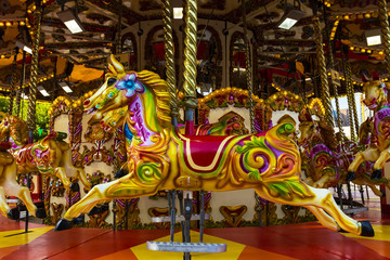 Brightly coloured carousel ponies.