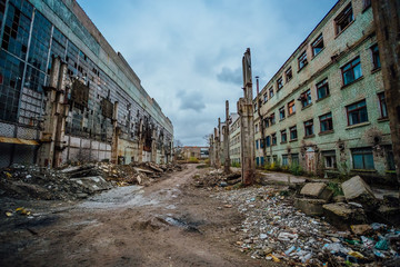 Territory of abandoned industrial area waiting for demolition. Junk at former Voronezh excavator factory  Wall mural