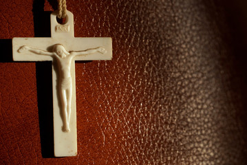 white cross crucifixion on the background of red skin closeup