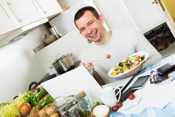 Freelancer working and holding vegies