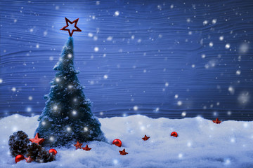 Christmas scene with fir tree in snow landscape and magic lights