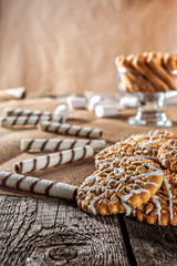 Still life recipe homemade honey ginger oatmeal cookie, pirouette rolled wafer and grain stick on wooden table kitchen
