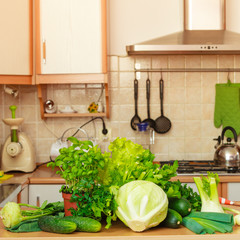 Many green vegetables on kitchen table
