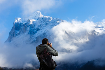 Male photographer taking pictures in Mountains