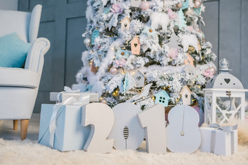 Happy New Year 2018. Christmas tree with 2018 numbers on the floor