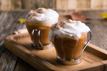 Pumpkin spice latte with whipped cream and pie spices