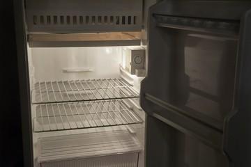 Empty refrigerator in the dark
