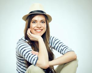 Portrait of smiling sitting woman wearing hat