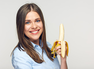 Beautiful business woman holding banana.