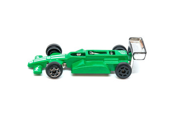 Photo of green toy model car isolated on white background