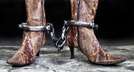 Boots in Chains and locked up..
