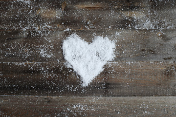 Old wood texture with snow heart