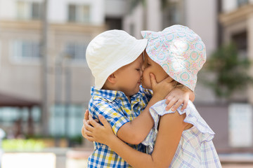 Closeup of Little Boy and Girl Hugging and Kissing