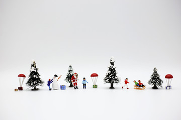 Miniature people: Colorful Christmas characters and decorations.