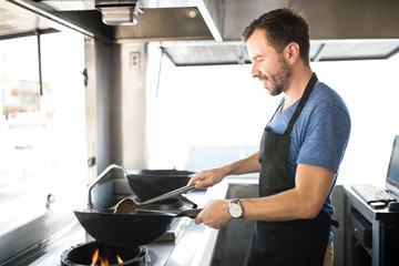 Male chef cooking in a food truck
