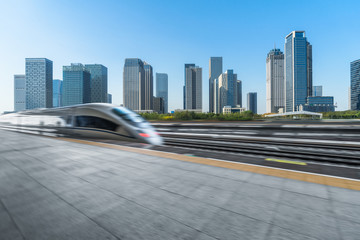 Fotomurales - very high-speed train go through the downtown city space , china