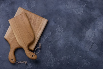 Two cutting boards from oak on stone background