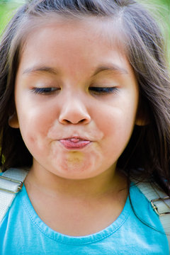 Little latin girl having difficulties to speak.