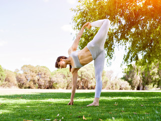 Young woman practicing yoga in the park