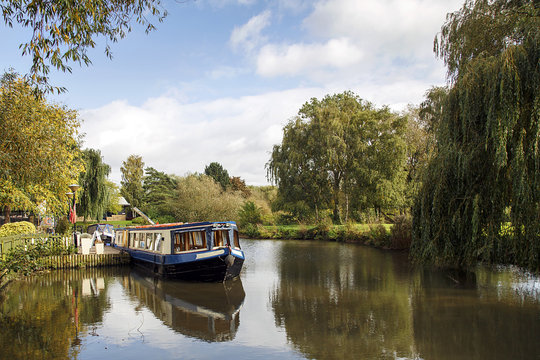 Narrow boat moored on the Avon canal awaiting tourists to cruise down the river through Stratford upon Avon