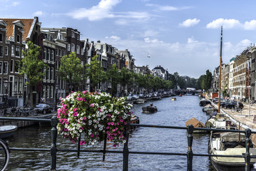panorama of traditional houses and an Amsterdam canal in the morning