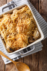 North American tetrazzini with chicken close-up in a baking dish. Vertical top view