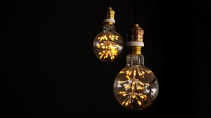 Light bulb on a black background.