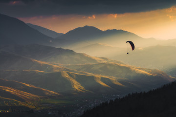 Silhouette of paraglider in a wonderful sun light