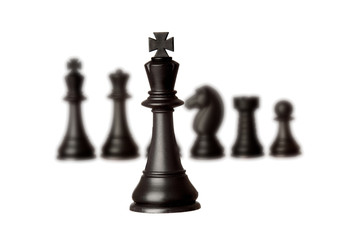 Black chess team with the king close-up