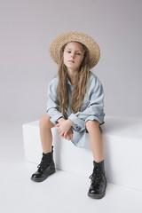 Stylish young teen girl over gray background