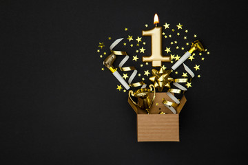 Number 1 gold celebration candle and gift box background