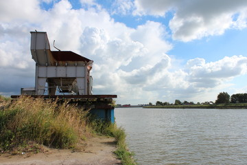 Sand silo along the river Hollandse IJssel in the Netherlands
