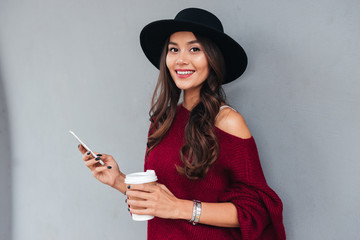 Portrait of a beautiful happy asian girl dressed in hat