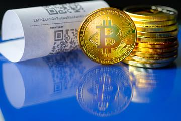 Bitcoin golden coins and paper receipt macro