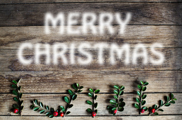 Merry Christmas frame on wooden background