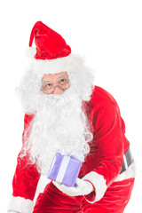 Happy merry Christmas Santa Claus pointing holding Gift Box with Isolated on white background.