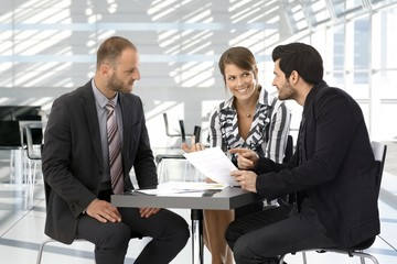 Business people having discussion by coffee table