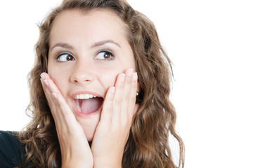 surprised young woman with hands on face isolated