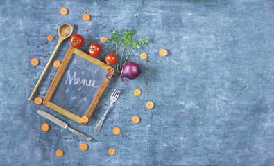 menu template, black bord, kitchen utensils,vegetables,free copy space