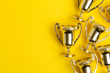 Gold winners achievement trophy on a yellow background Fotobehang
