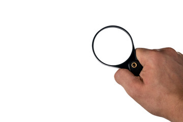 hand with magnifier on white isolated background