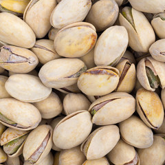 Close view of all natural roasted pistachio nuts.
