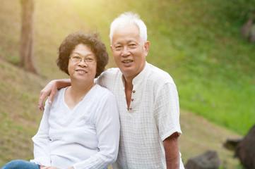 Elderly Asian couple outdoor.