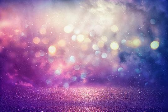 Purple glitter lights background. defocused.