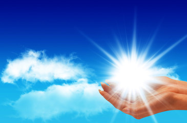Sun In the hands on the blue sky