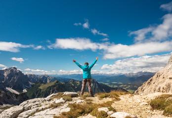 Sport women on top of mountain