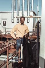 african american man sitting on guardrails